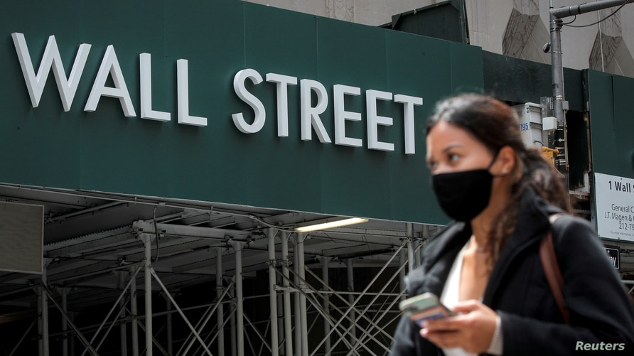 FILE PHOTO: A Wall St. sign is seen near the NYSE in New York