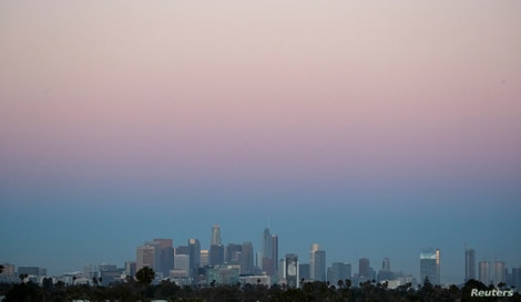 The downtown skyline is pictured at dusk during the outbreak of the coronavirus disease (COVID-19), in Los Angeles, California,…