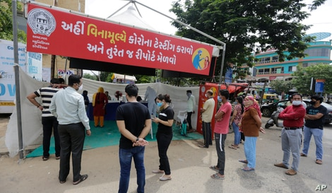 Indians queue up to test for COVID-19 in Ahmedabad, India, Saturday, Sept. 26, 2020. The nation of 1.3 billion people is…