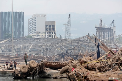 People are pictured at the devastated site of the explosion at the port of Beirut, Lebanon August 6, 2020. Thibault Camus/Pool…
