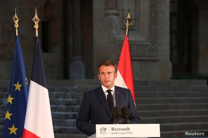 French President Emmanuel Macron delivers his speech during a news conference, following Tuesday's blast in Beirut's port area,…
