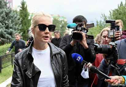 Yulia Navalnaya, wife of Russian opposition leader Alexei Navalny, speaks with the media outside a hospital, where Alexei…