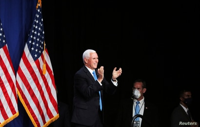 Vice President Mike Pence applauds in the Charlotte Convention Center's Richardson Ballroom in Charlotte, where delegates have…