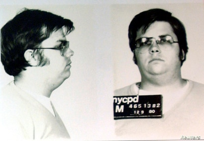 FILE PHOTO: A mug-shot of Mark David Chapman, who shot and killed John Lennon, is displayed on the 25th anniversary of Lennon's…