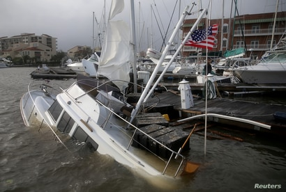 An U.S. flag flies from a boat damaged by Hurricane Sally in Pensacola, Florida, U.S., September 16, 2020.  REUTERS/Jonathan…