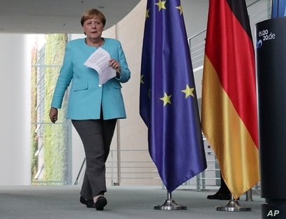 German Chancellor Angela Merkel arrives for a press conference at the Chancellery in Berlin, Germany, Aug. 19, 2020.