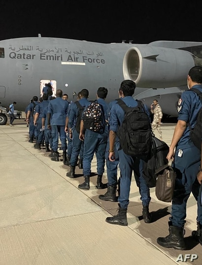 A handout picture released by Qatar's Emiri Air Force on August 6, 2020, shows members of Qatar's military search and rescue…
