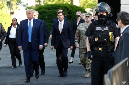 FILE - In this June 1, 2020, file photo President Donald Trump departs the White House to visit outside St. John's Church in…