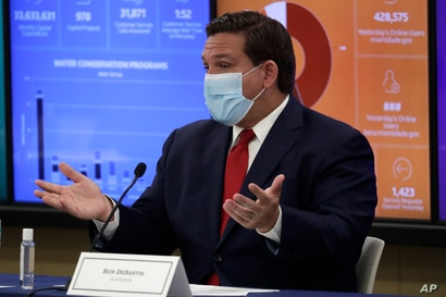 Florida Gov. Ron DeSantis speaks during a roundtable discussion with Miami-Dade County mayors during the coronavirus pandemic,…