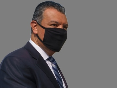 Alex Padilla headshot, as California Secretary of State, graphic element on gray