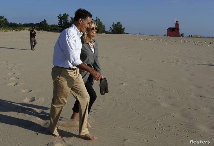 Romeny walks with his wife by lake Michigan after campaign act.