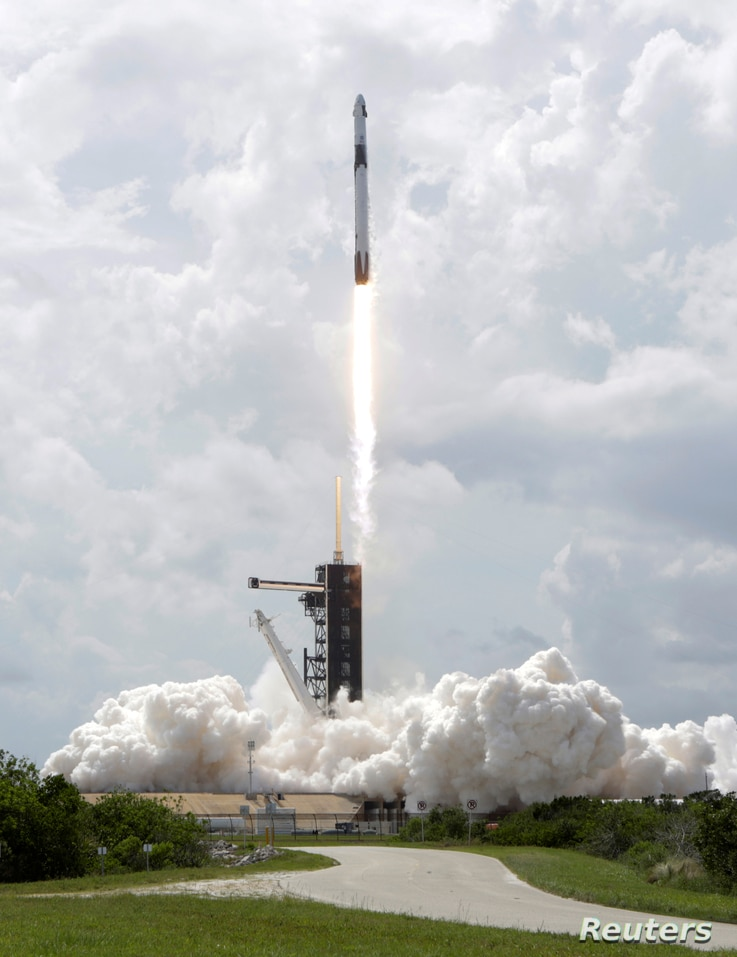 A SpaceX Falcon 9 rocket and Crew Dragon spacecraft carrying NASA astronauts Douglas Hurley and Robert Behnken lifts off during…