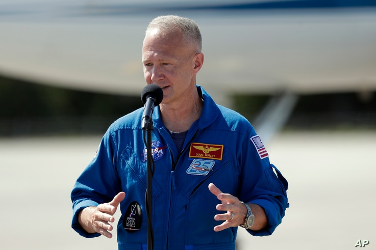 NASA astronaut Doug Hurley speaks at a news conference after he arrives at the Kennedy Space Center in Cape Canaveral, Fla.,…