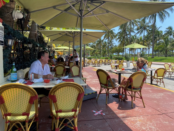 People sit at Il Giardino restaurant as restaurants reopen with restrictions to limit the spread of the coronavirus disease …