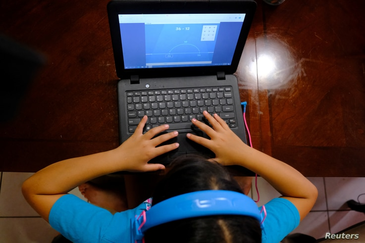 Hazeline Panditaratne completes her math assessments  from her computer in Broward County, Florida, U.S. May 29, 2020. Picture…