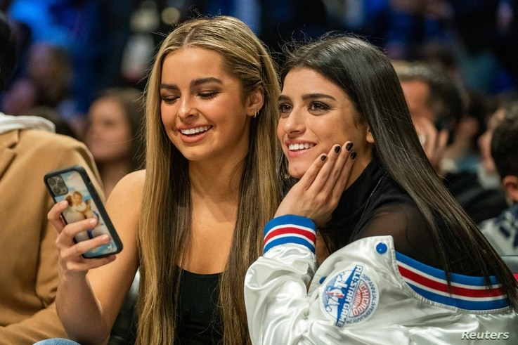 February 15, 2020; Chicago, Illinois, USA; TikTok social media personalities Addison Rae (left) and Dixie D'Amelio (right)…