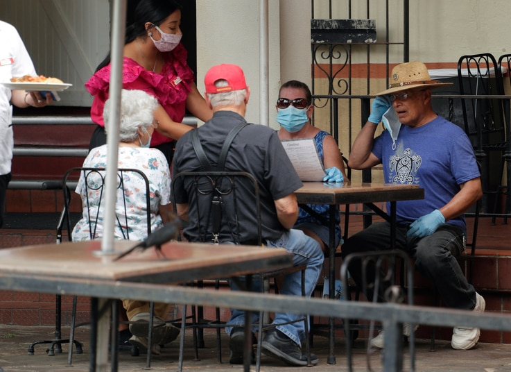 Diners at a restaurant along the River Walk that has reopened in San Antonio, Monday, June 15, 2020, in San Antonio. The…