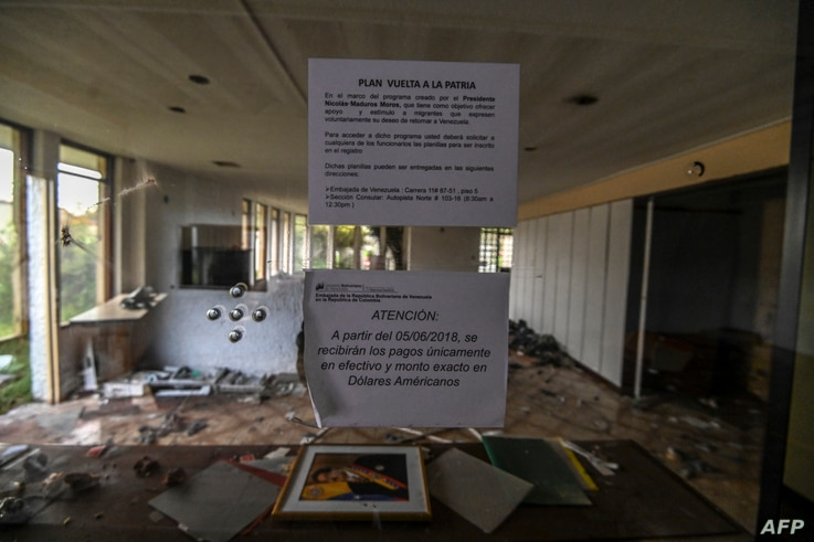 General view of Venezuelan consulate in Bogota in ruins after being looted for months, on July 28, 2020. - The Venezuelan…