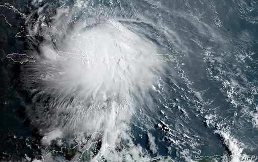 This RAMMB/NOAA satellite image obtained on August 23, 2020, shows Tropical Storm Laura moving over Haiti and the Dominican…