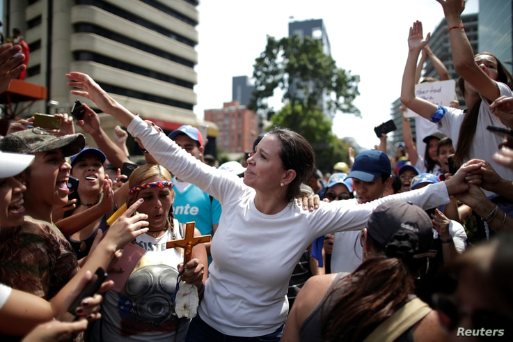 Venezuelan opposition leader Maria Corina Machado takes part in a rally against the government of Venezuela's President Nicolas…