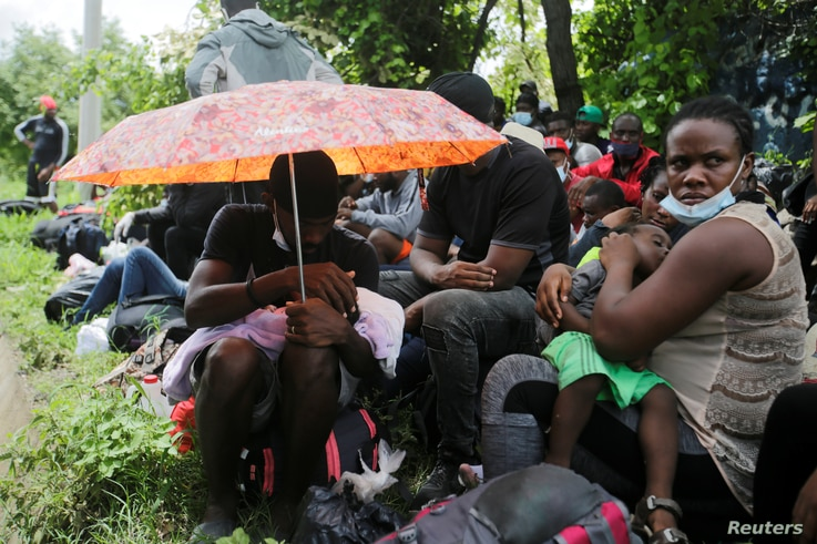 African, Cuban and Haitian migrants, which are stranded in Honduras after borders were closed due to the coronavirus disease …