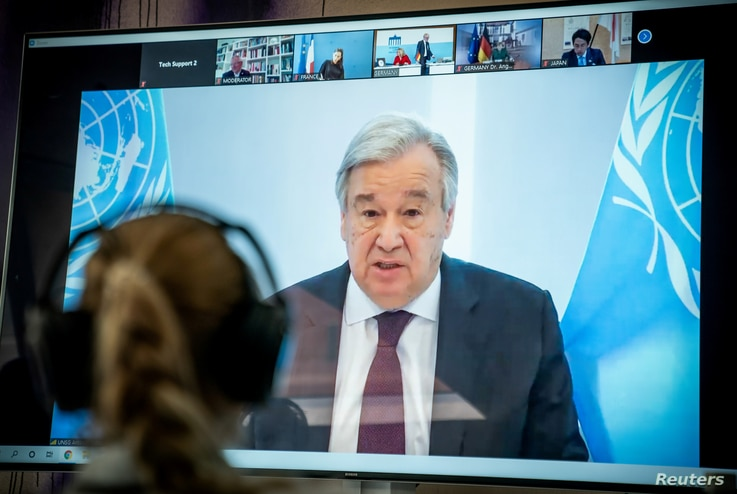 FILE PHOTO: United Nations Secretary-General Antonio Guterres is seen on a video screen during a virtual climate summit, known…
