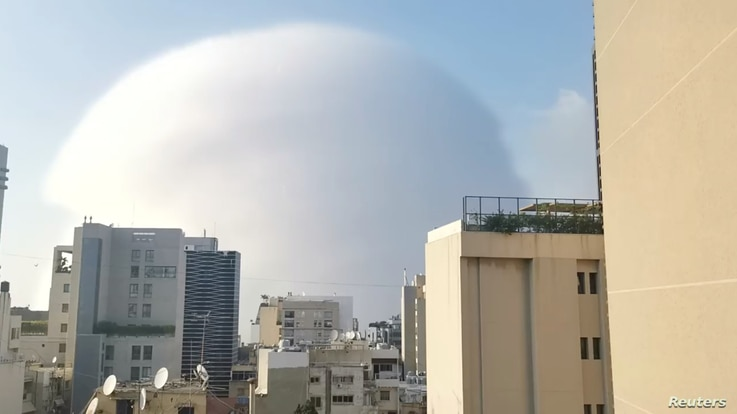 A shockwave is seen during an explosion in Beirut, Lebanon August 4, 2020, in this picture obtained from a social media video…