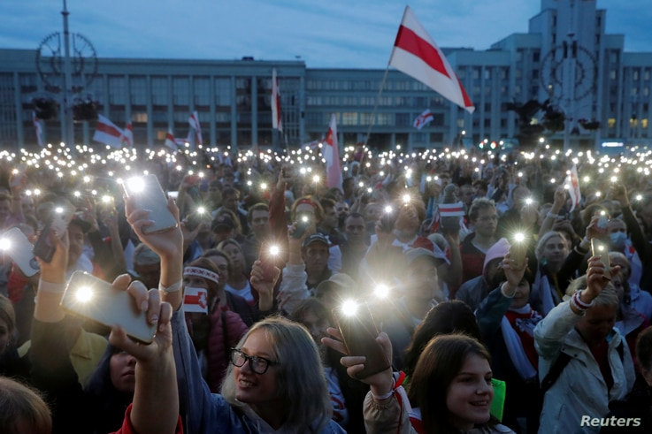 FILE PHOTO: People flash lights from their phones during an opposition demonstration to protest against presidential election…