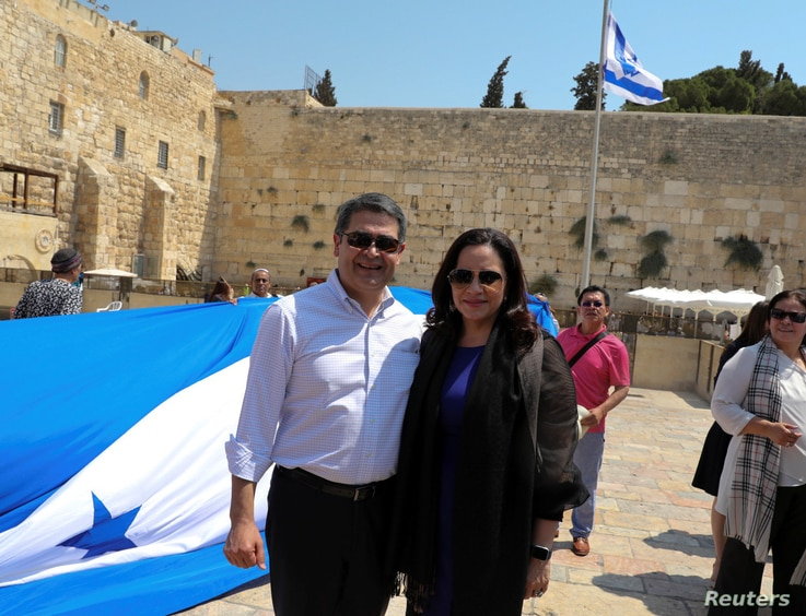 Honduras' President Juan Orlando Hernandez and his wife Ana Garcia are pictured at the Western Wall hours before the opening of…