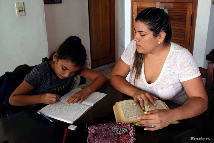 A girl does his homework after the closing of schools during the nationwide quarantine due to coronavirus disease (COVID-19)…