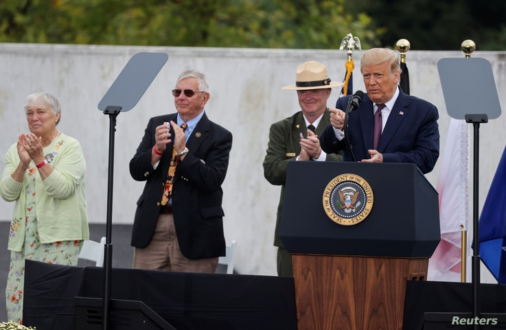 U.S. President Donald Trump acknowledges guests as he speaks during a ceremony at the Flight 93 National Memorial, remembering…