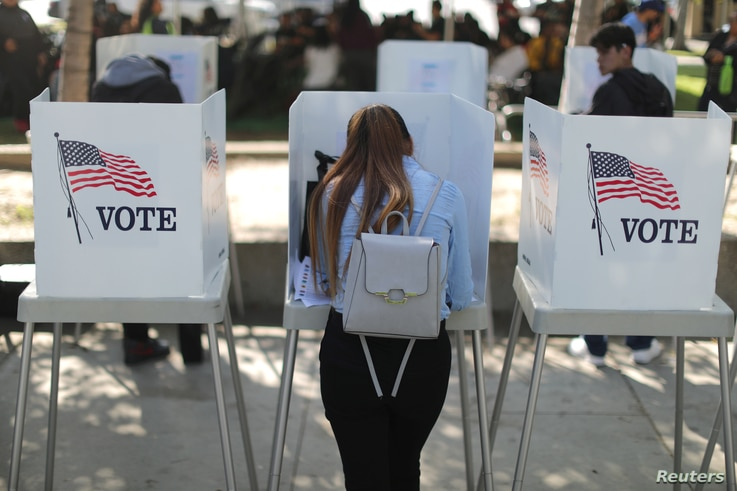 Desteny Martinez, 18, votes for the first time, in the U.S. congressional and gubernatorial midterm elections in Norwalk,…