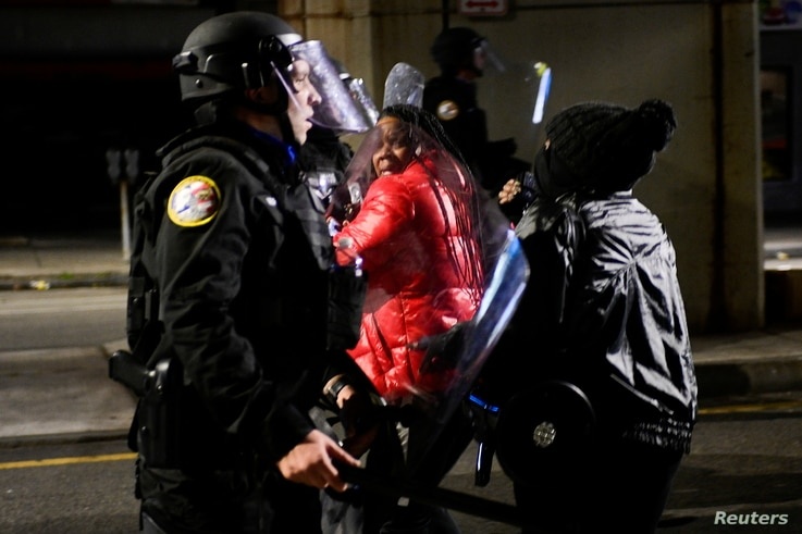 Demonstrators clash with riot police during a rally after the death of Walter Wallace Jr., a Black man who was shot by police…