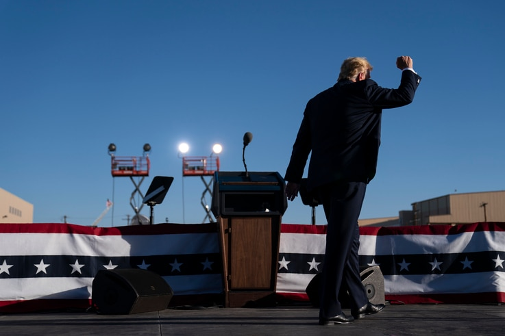 President Donald Trump walks off stage after speaking during a campaign rally at Phoenix Goodyear Airport, Wednesday, Oct. 28,…