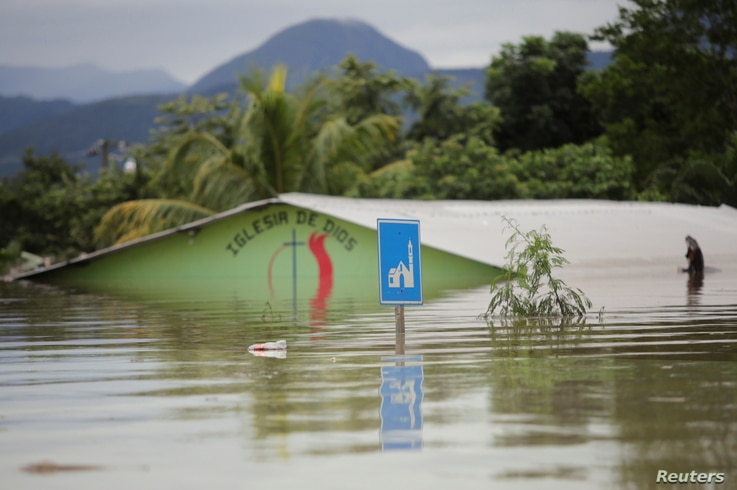 A submerged evangelical church is seen along a flooded street during the passage of Storm Eta, in Pimienta, Honduras November 5…