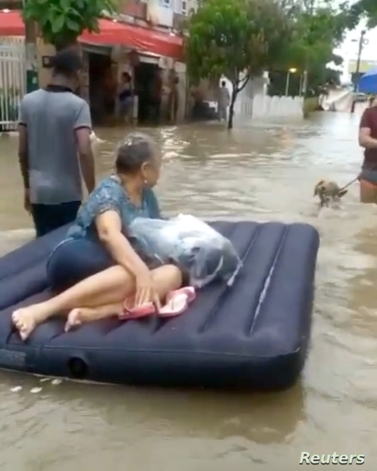 A woman is evacuated on a raft amid floodwaters caused by Hurricane Iota in Cartagena, Colombia in this still image taken from…
