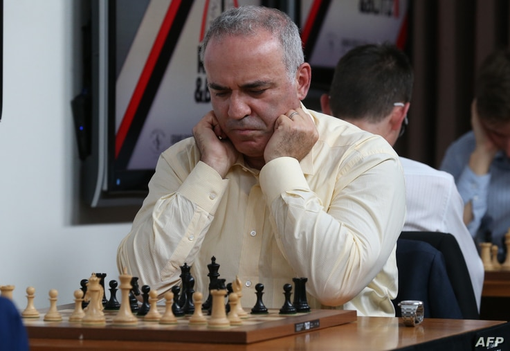 Grandmaster chess player Garry Kasparov contemplates his move during a match against fellow grandmaster Levon Aronian on day…