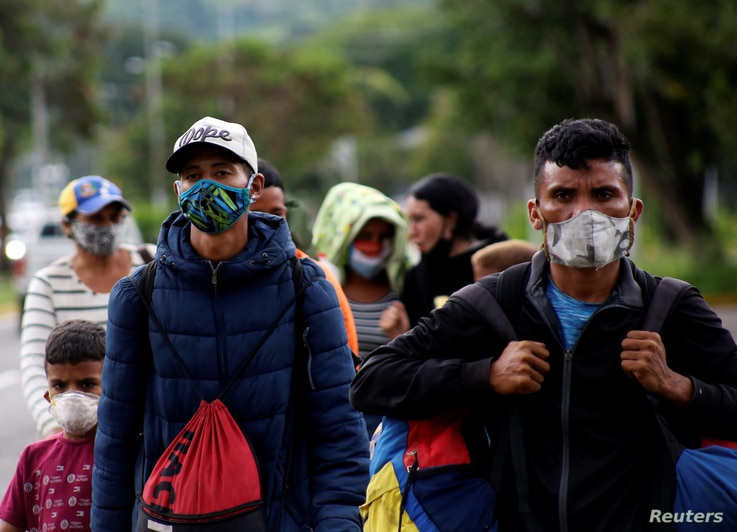 Venezuelan migrants walk towards the border between Venezuela and Colombia during the coronavirus disease (COVID-19) outbreak,…
