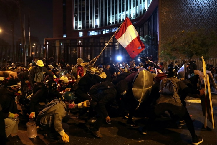 Demonstrators clash with police during protests that led to the resignation of Peru's interim President Manuel Merino, in Lima,…