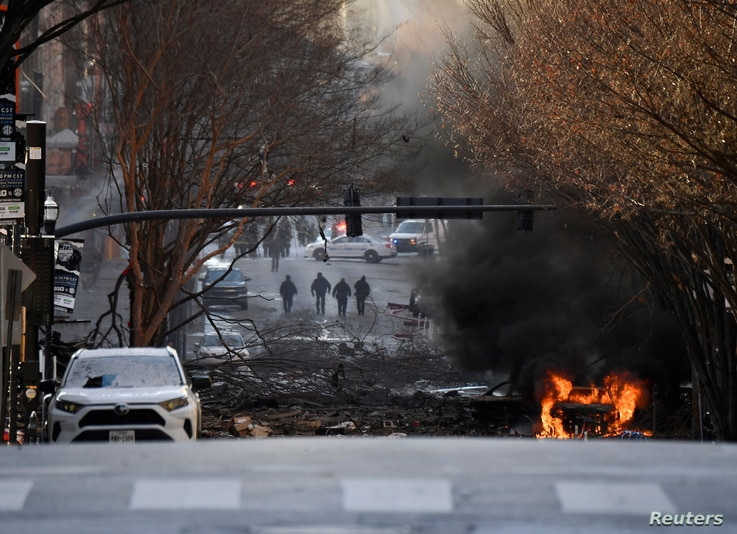 A vehicle burns near the site of an explosion in the area of Second and Commerce in Nashville, Tennessee, U.S. December 25,…