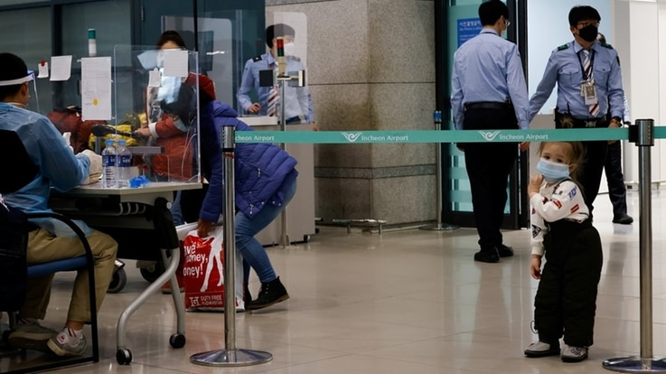 Passengers from overseas arrive at the Incheon International Airport, amid the coronavirus disease (COVID-19) pandemic in Incheon, South Korea, Dec. 28, 2020.