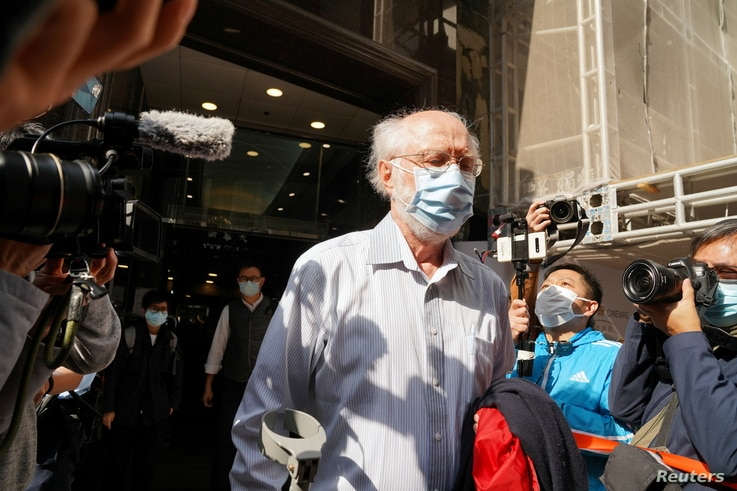 American lawyer John Clancey walks out of a building as he is taken away by police officers in Hong Kong, China January 6, 2021…