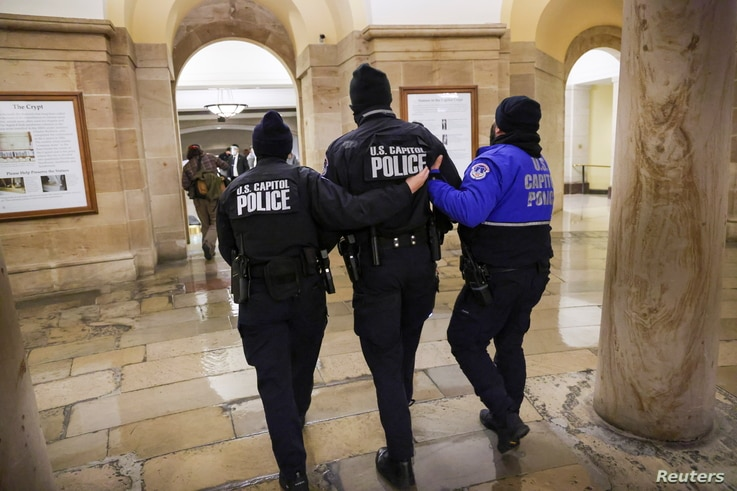 Members of the U.S. Capitol Police walk inside the Capitol as supporters of U.S. President Donald Trump protest outside, in…