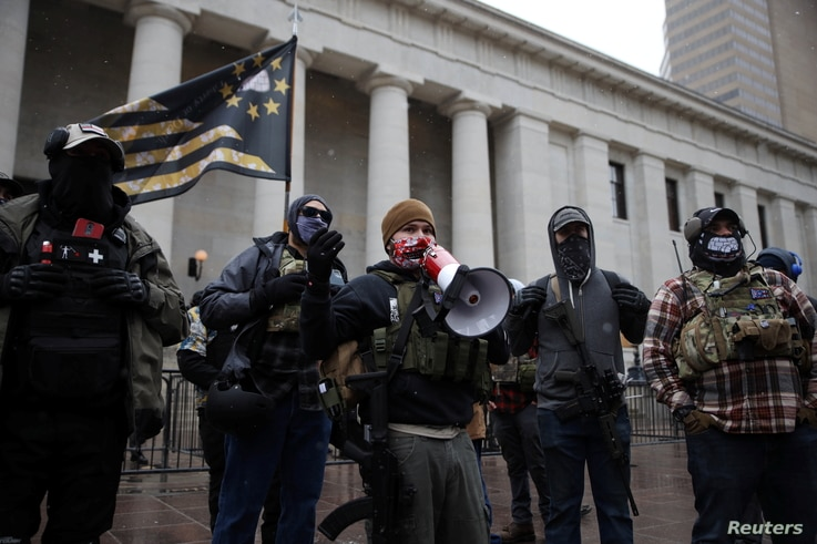 Militia groups gather to protect protesters as supporters of U.S. President Donald Trump protest against the election of…