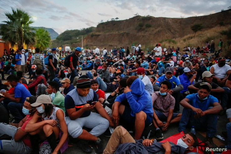 Hondurans taking part in a new caravan of migrants, set to head to the United States, rest on a road, in Vado Hondo, Guatemala…
