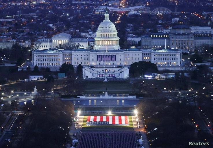 "The U.S. Capitol Building is prepared for the inauguration ceremonies for President-elect Joe Biden as the ""Field of Flags"" are…"