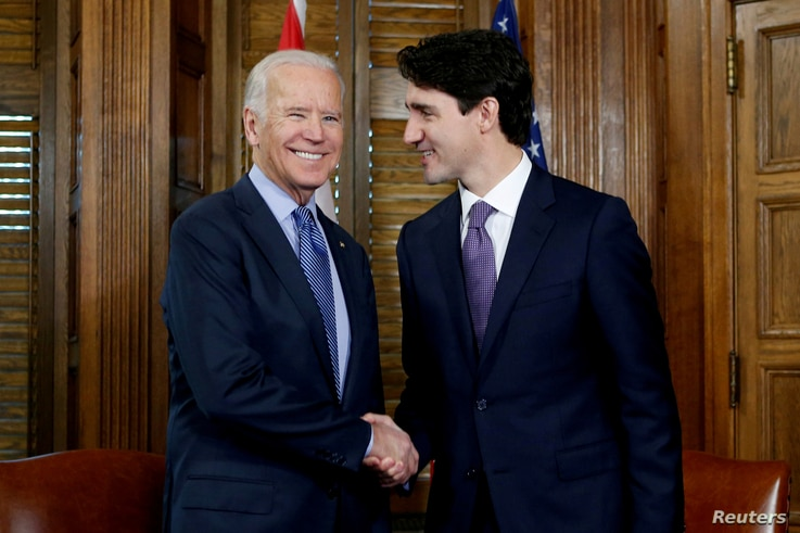 FILE PHOTO: Canada's Prime Minister Justin Trudeau (R) shakes hands with U.S. Vice President Joe Biden during a meeting in…