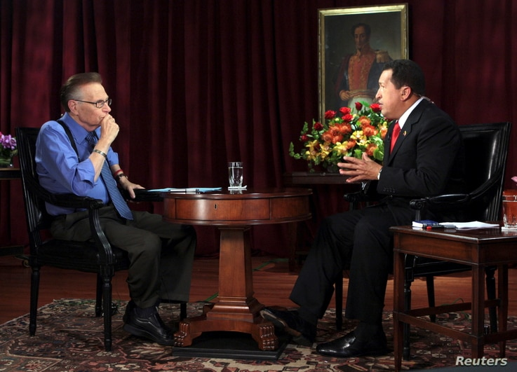 FILE PHOTO: Venezuela's President Hugo Chavez (R) is interviewed by CNN journalist Larry King in New York, U.S., September 24,…