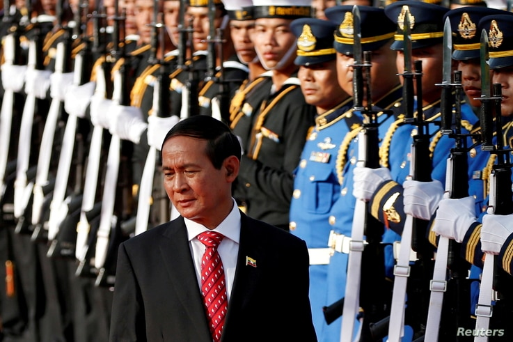 FILE PHOTO: Myanmar's President Win Myint reviews the honor guard during his welcome ceremony at the Government House in…