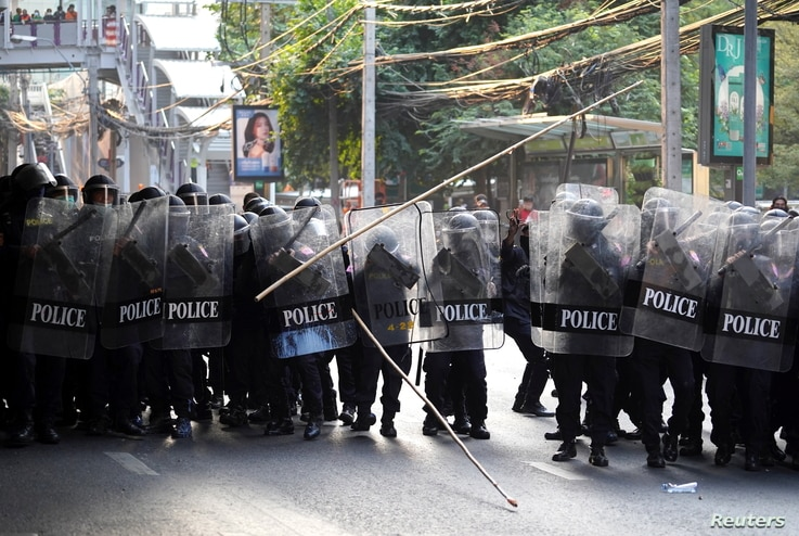 Sticks fly as anti-Thai government protesters clash with riot police after protesters showed up at a rally for Myanmar's…